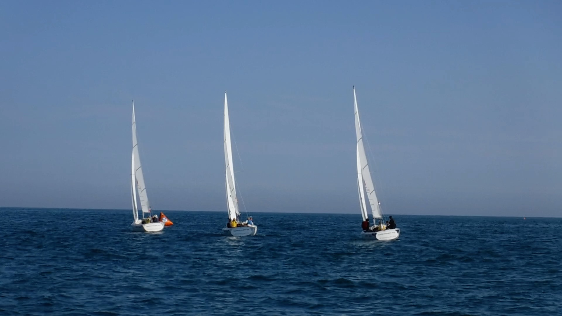 Three sailing boats very close together