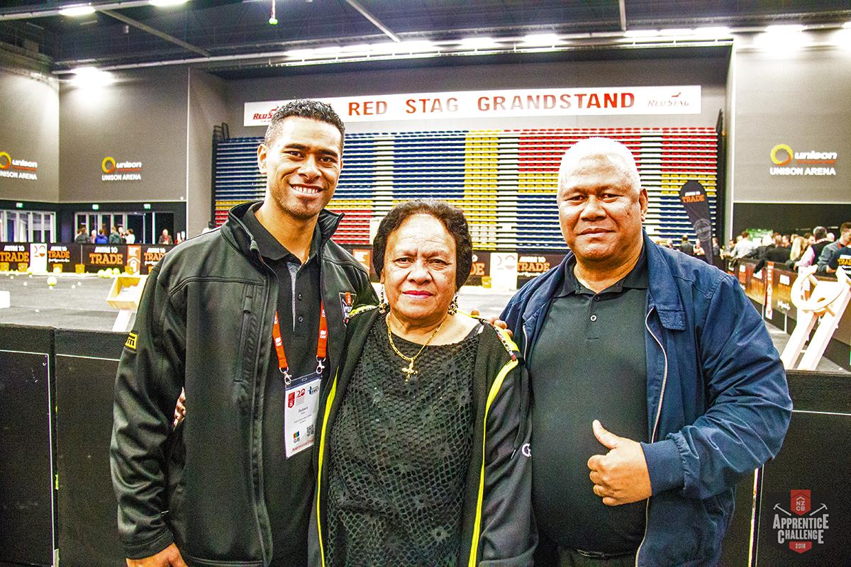 Robert Piutau with his parents