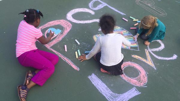 Three girls chalk drawing