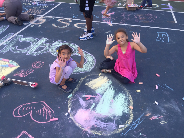 Chalk drawing girls showing hands