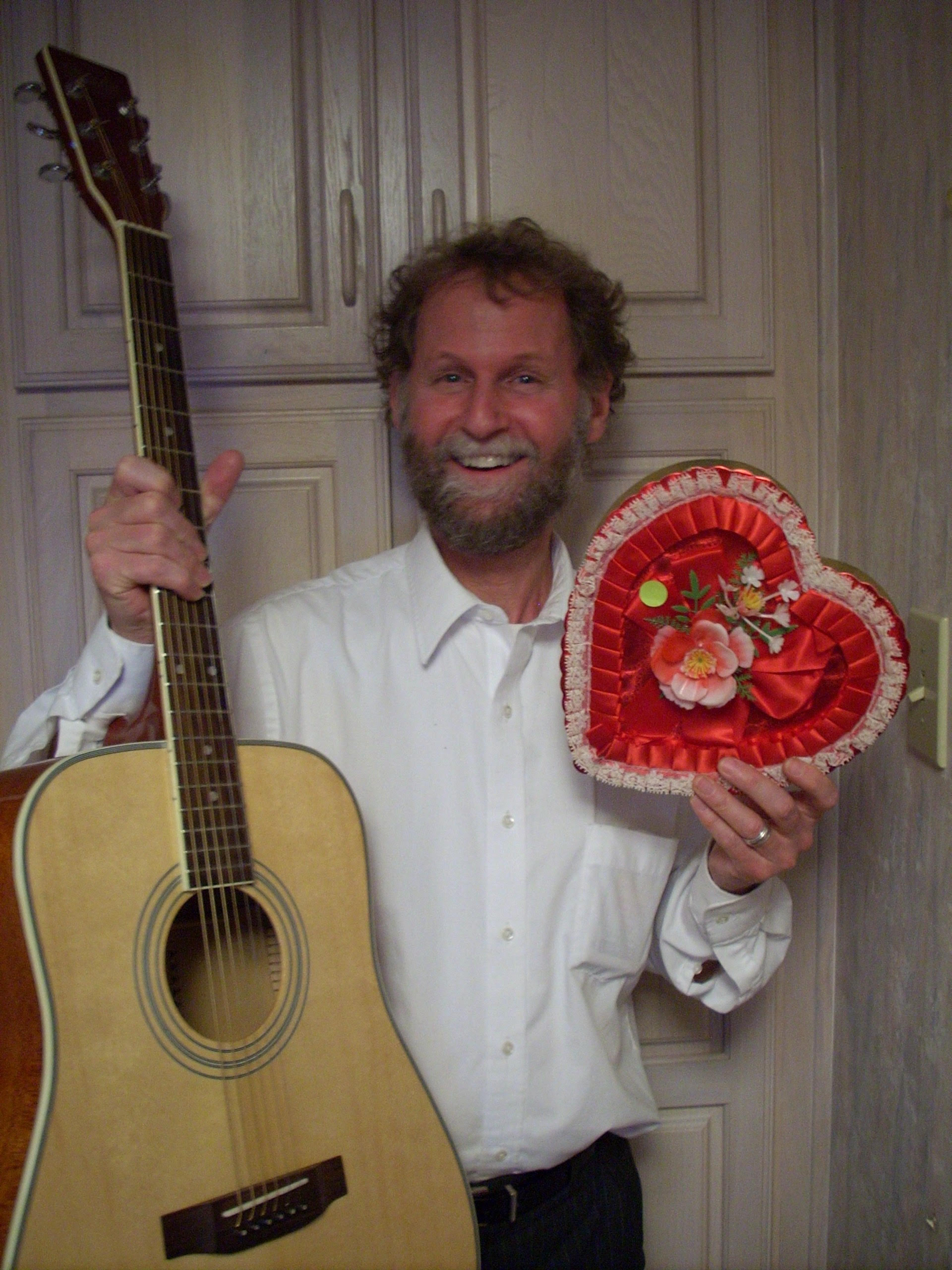 Bill Cohen with guitar and valentine