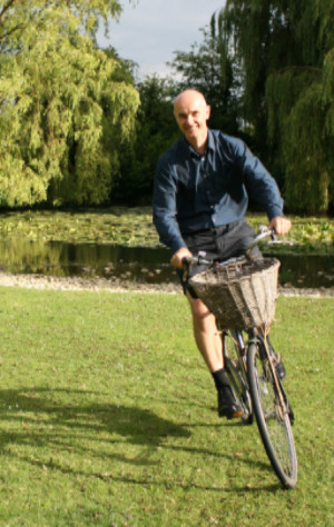 David MacKay with a big smile and his bicycle