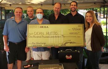 MESA Team presents Dean with check