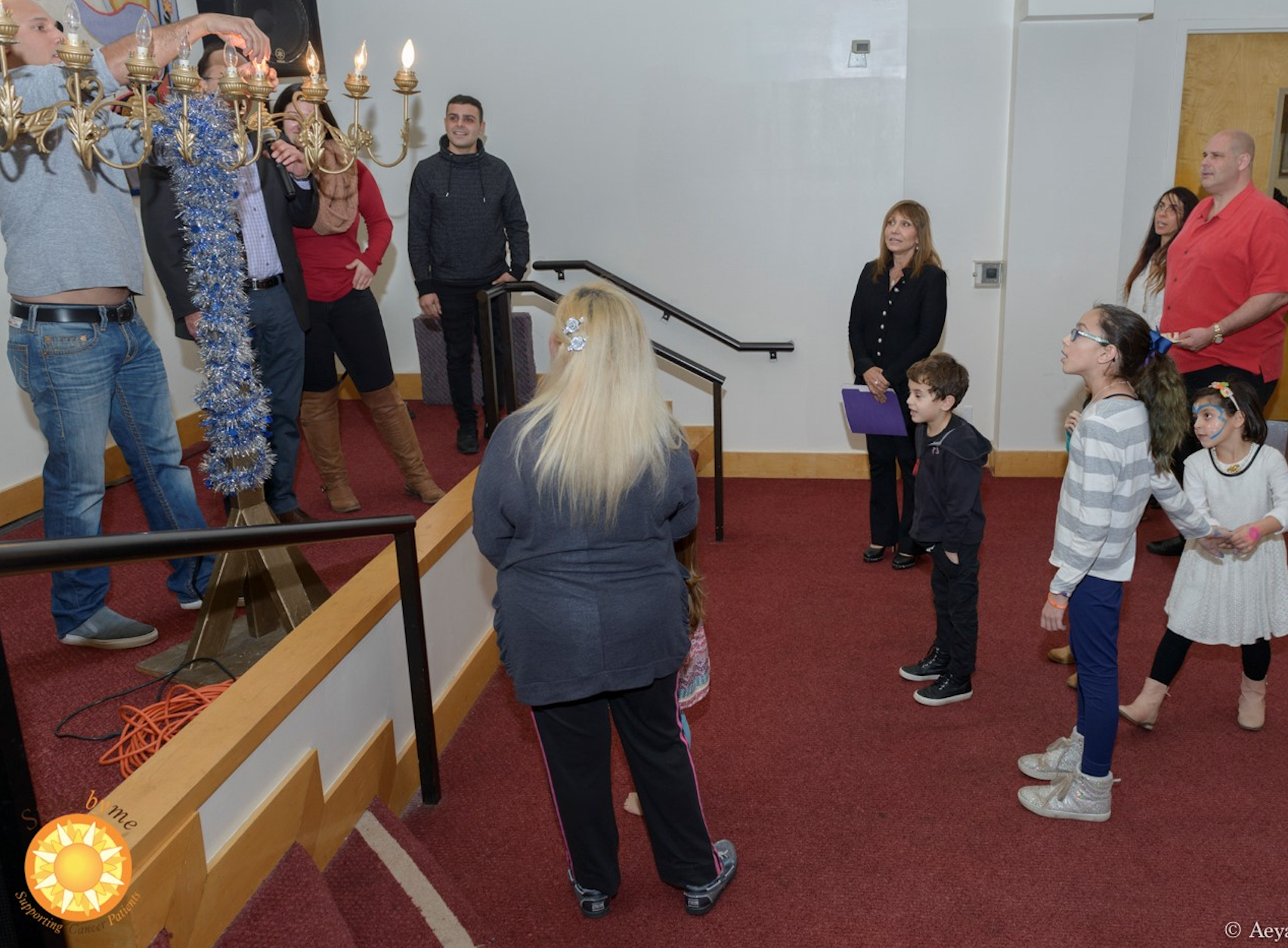 Children watch the menorah lighting
