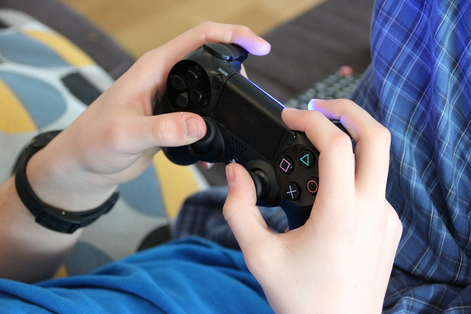 Image of a teen boy playing video games