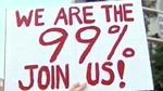 """We are the 99% Join Us"" banner at public demonstration."