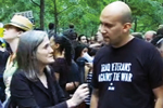 Amy Goodman interviewing a soldier demonstrating against the war.