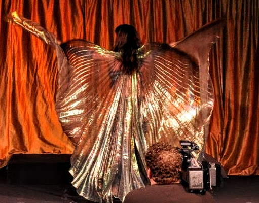 Dilara Sultan performs on set with Isis Wings, one of the iconic props in Belly Dance. Learn from her at The Belly Dance Studio 409-790-7669