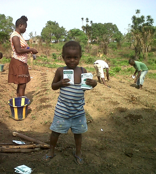 image: child with seed packets