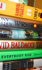 Image of several hardcover books in a stack