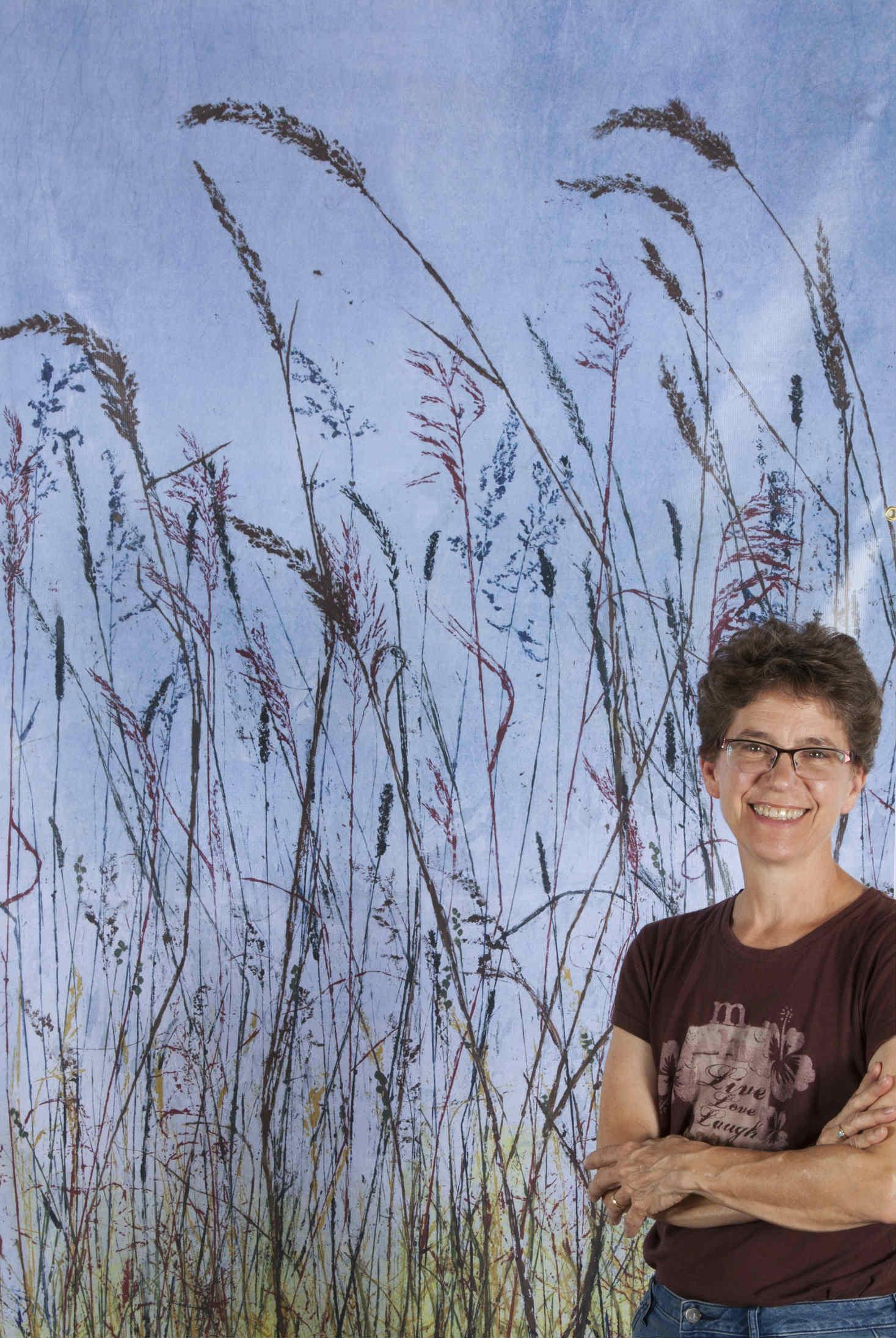 "Linda Snouffer standing in front of a 7' x 4' replica of ""Urban Prairie"" ©Linda Snouffer, Botanical Printmaker        Lindasnouffer.com"