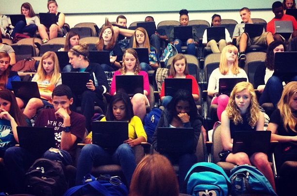 Students with laptops in class