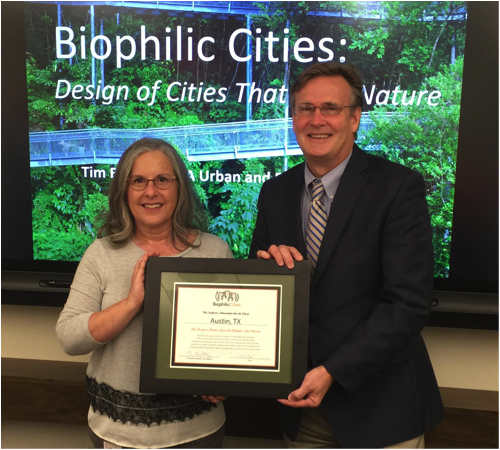 Dr. Tim Beatley, Founder and Director of the Biophilic Cities Project, presents Councilwoman Leslie Pool with a certificate welcoming Austin, Texas into the Biophilic Cities Network. Credit: Leah Haynie