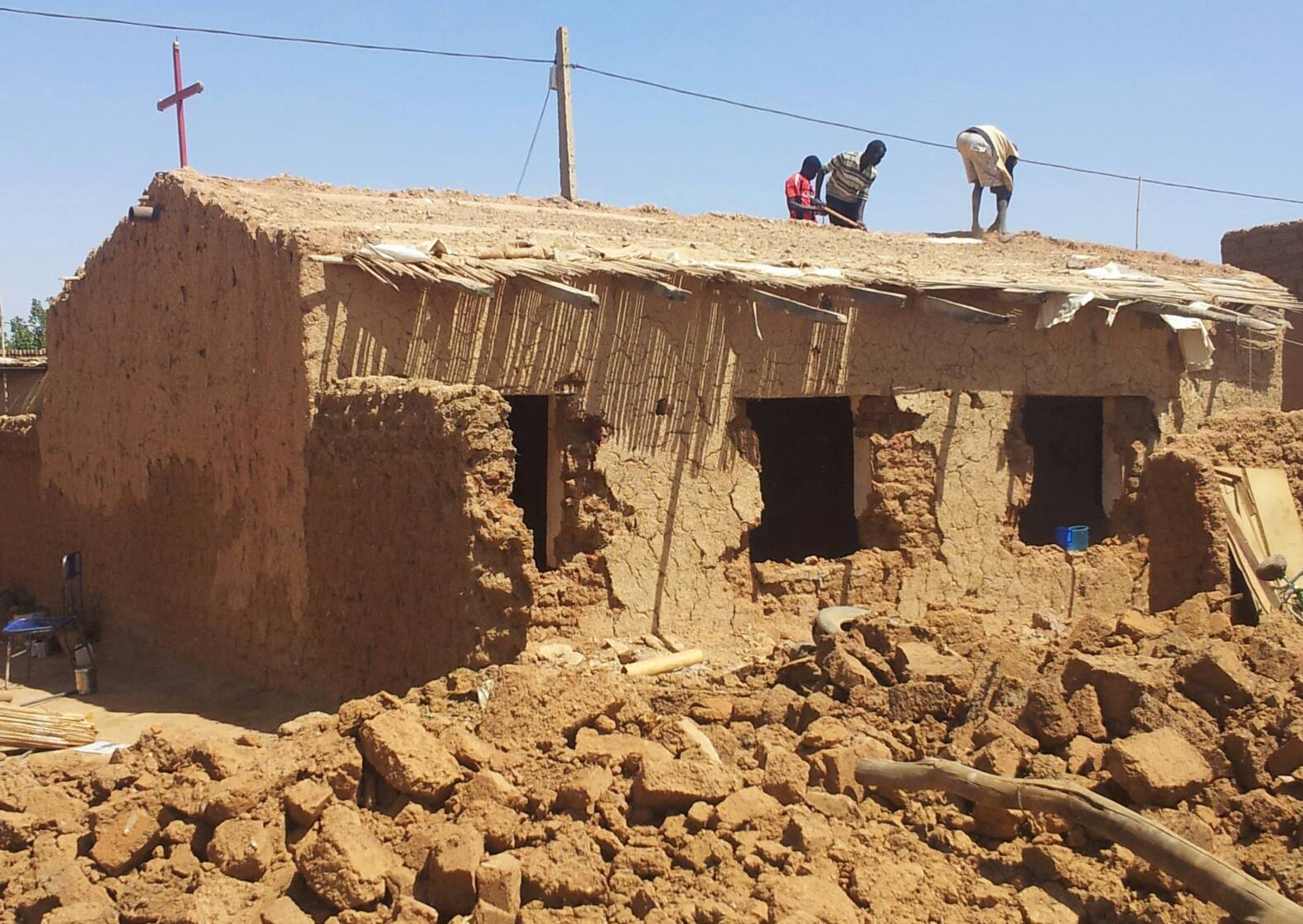 Workers tear down church building in Omdurman, Sudan. (Morning Star News