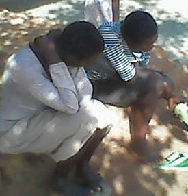 Two daughters, 22 and 17, mourn the death of their father, Yokannah Zirinkuma. (Morning Star News)