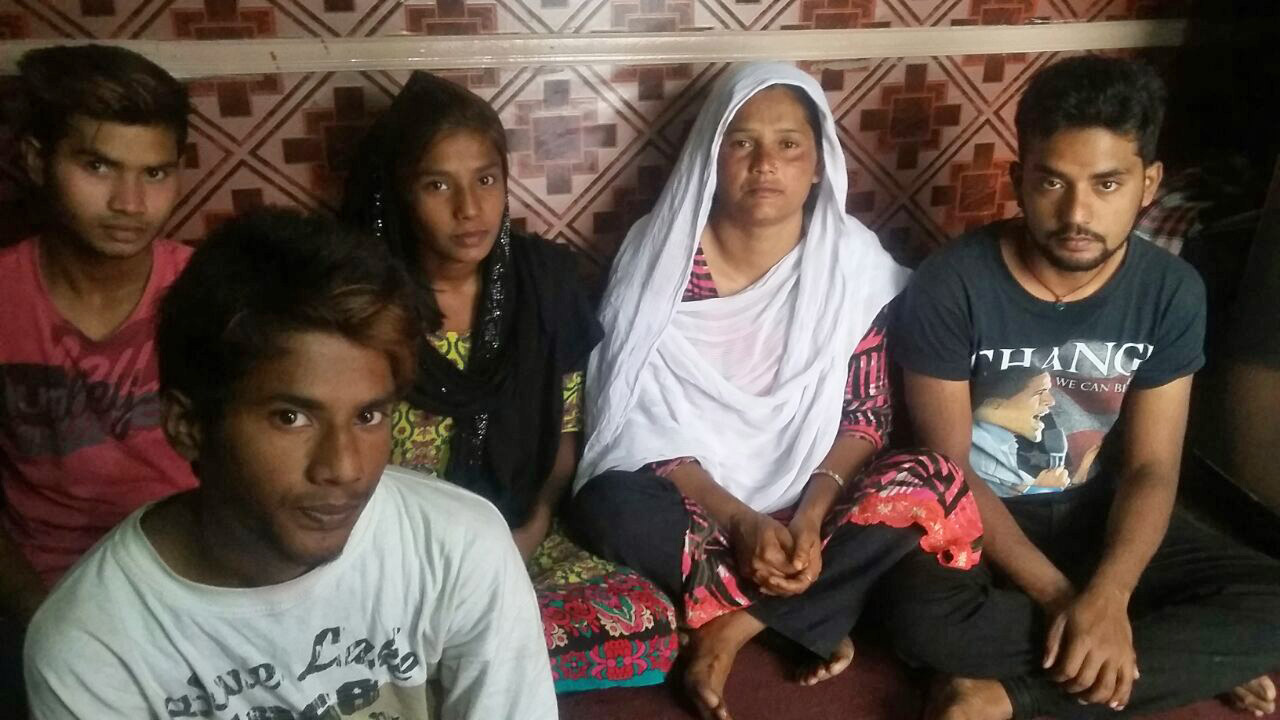 Noman Masih's mother, Khalida Bibi, with her other children. (Morning Star News)