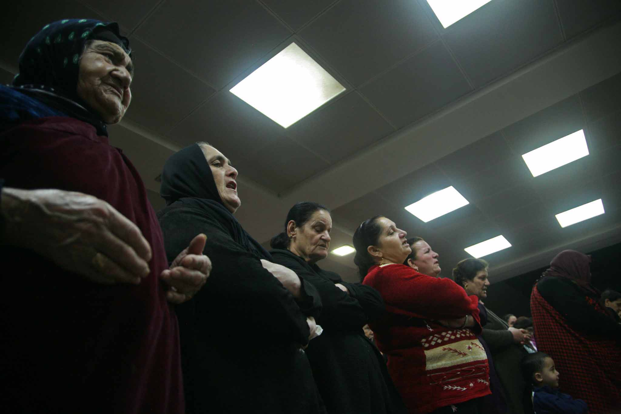 Iraqis pray at mass observed in office complex in Erbil converted to house about 350 Christian families. (Morning Star News)