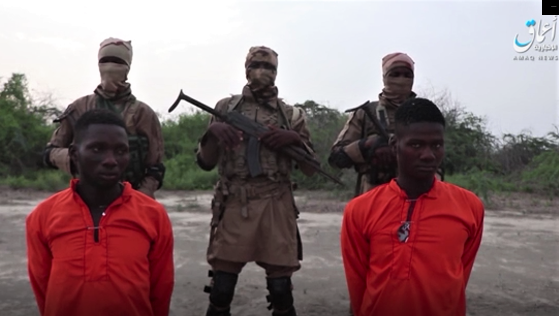 Screen capture from Islamic State's Amaq news site of Christian aid workers Godfrey Ali Shikagham (left) and Lawrence Duna Dacighir, before their execution by Boko Haram. (Morning Star News)