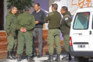 A member of Pueblo Grande Baptist Church talks with Argentine gendarmerie after vandalization. (Morning Star News via Pueblo Grande Baptist Church)