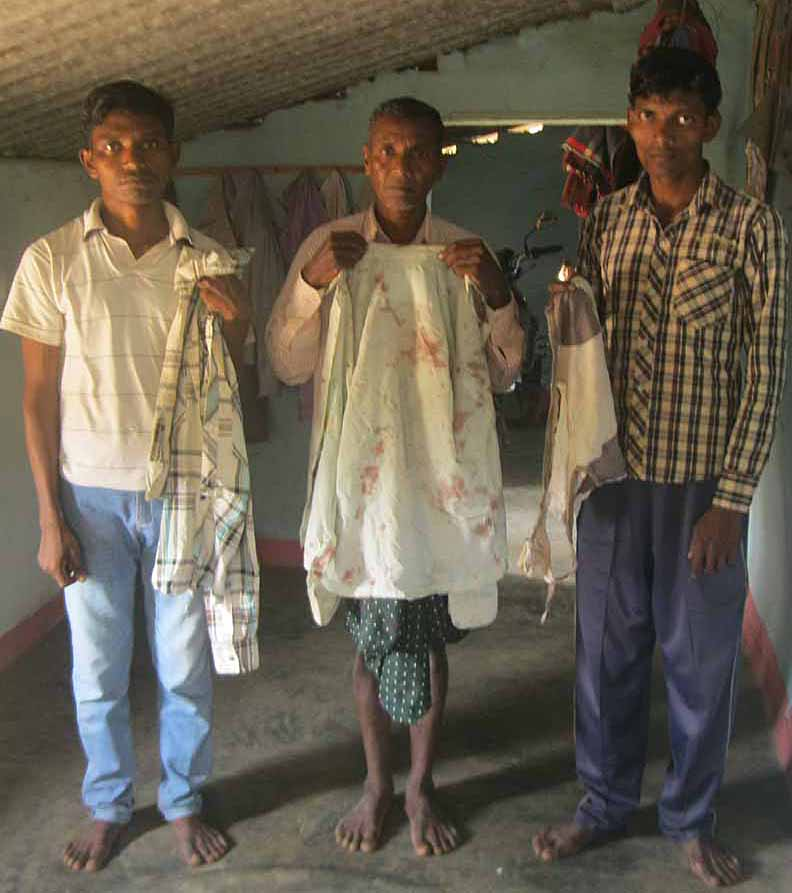 Irma Markami and his sons with bloodied and torn clothing. (Morning Star News).