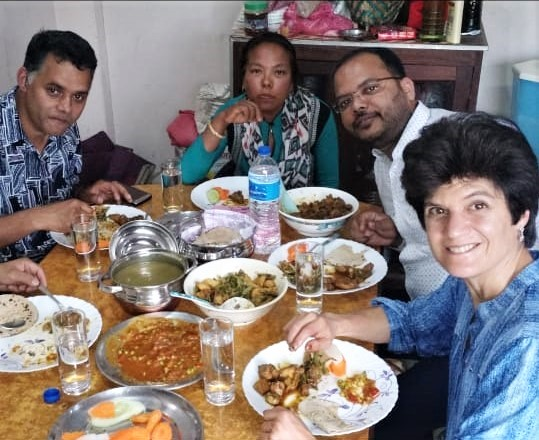 (From left) Pastor Dilli Ram Poudel, Kunsang Tamang, Gaurav Shrivastava and Oleana Cinquanta share a meal in Nepal. (Morning Star News)