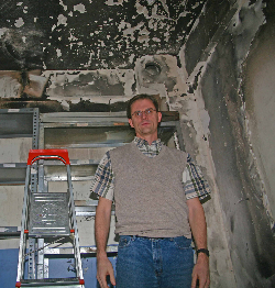 David Byle amid fire damage at Bible Correspondence Course in Turkey. (Morning Star News)
