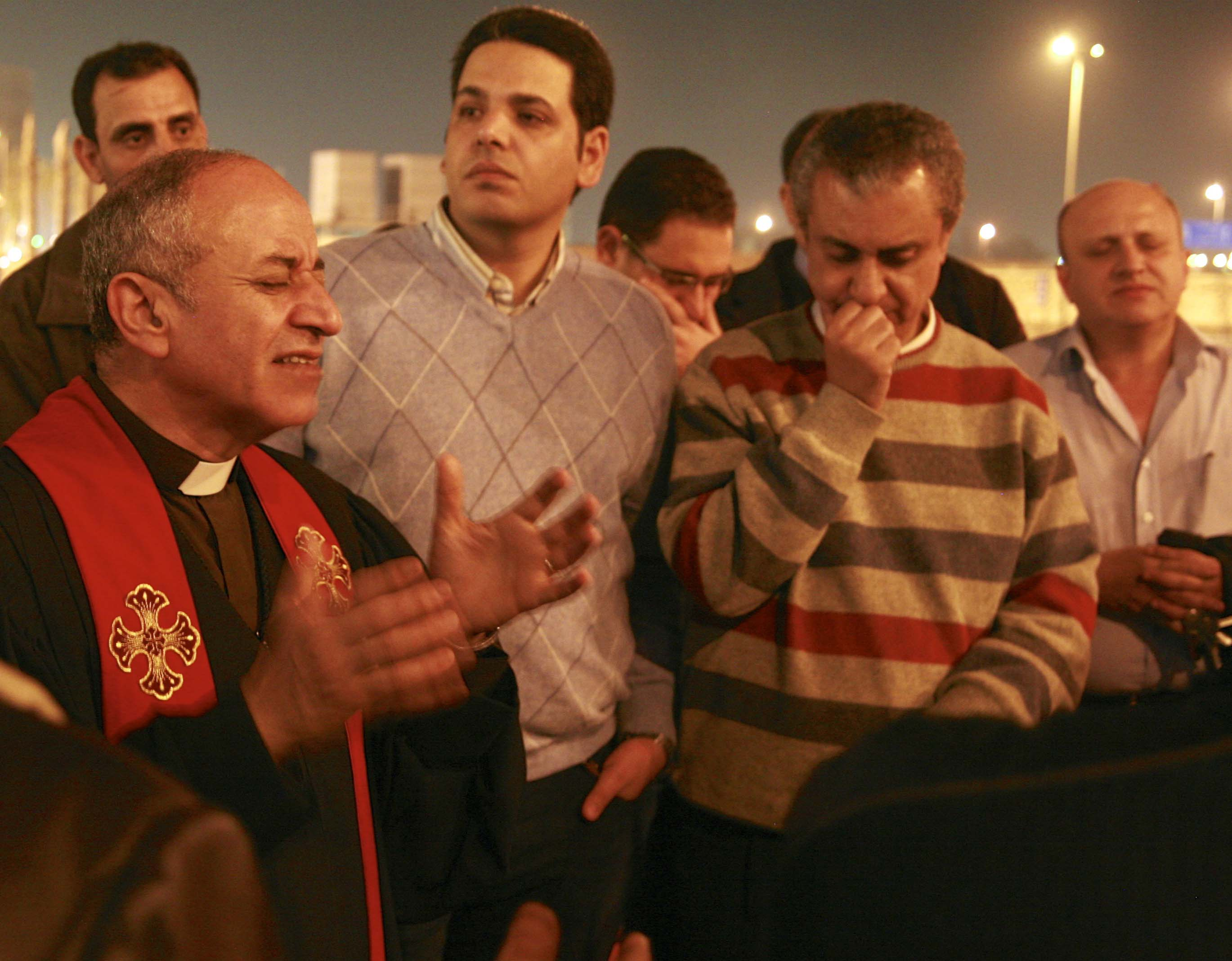 Clergymen and fellow Christians prayed and sang outside Cairo's airport after Atallah's body arrived Tuesday night (March 12).