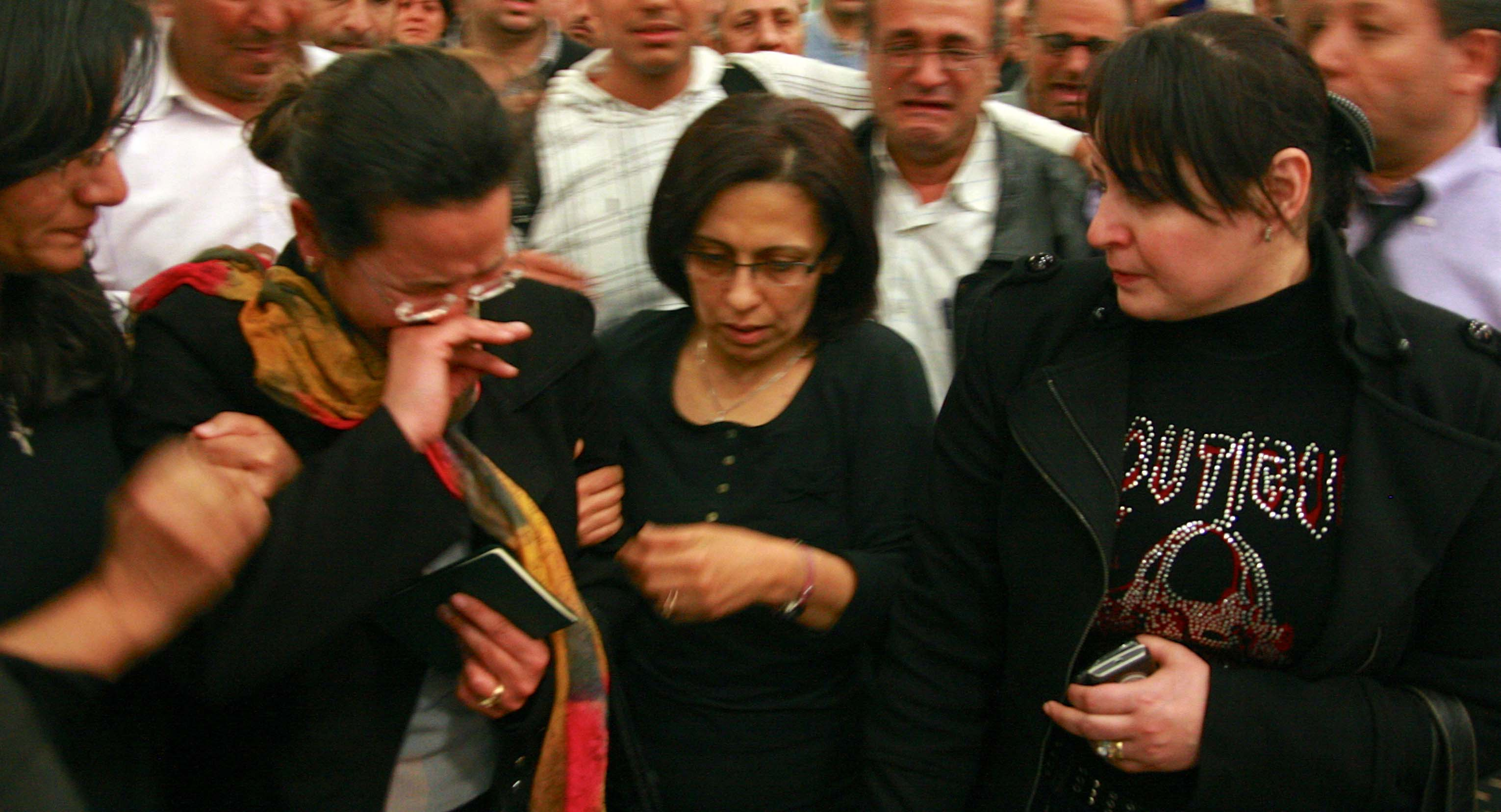 More than 100 Christians greeted Atallah's widow Ragaa Nagah (second from left) at Cairo's airport when she arrived from Libya. (Morning Star News photo).