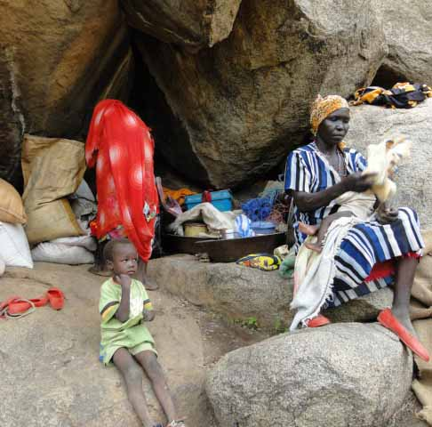 Some of the thousands of Nuba Mountain civilians who have taken refuge from government bombing in caves. (Diocese of El Obeid photo)