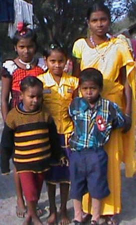 Widow and children of Baishakhu Malto Pahari. (Morning Star News photo)