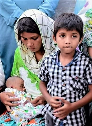Wife of slain Amir Masih with 2-week-old and 7-year-old sons. (Morning Star News courtesy of family)
