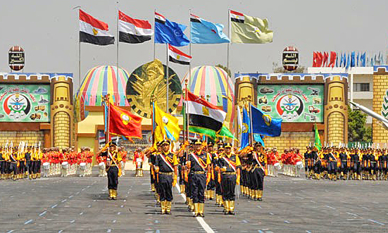 Egyptian soldiers carry flags of branches of the military. (Wikipedia, Egptian military)