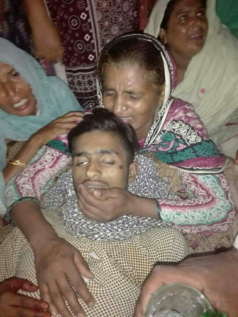 Arsalan Masih's mother mourns over his body. (Morning Star News courtesy of attorney)