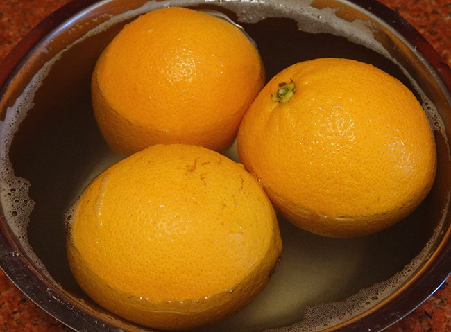 oranges soaking in vinegar-salt-solution
