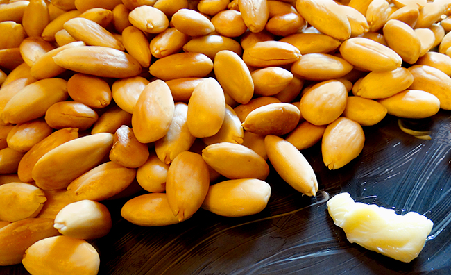 toasted almonds on cookie sheet