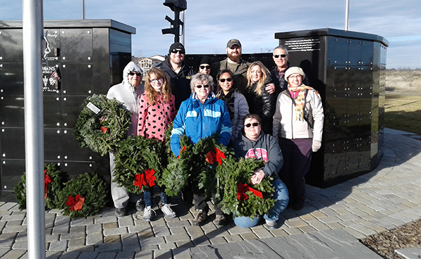 Bechtel employees pose at the Wreaths Across America event.
