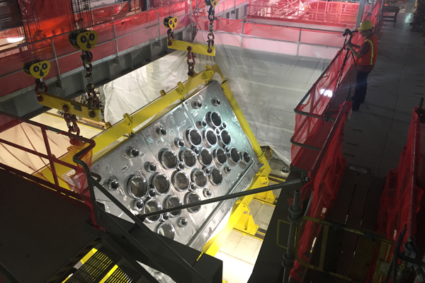 A 12-foot by 22-foot melter lid is flipped inside the Low-Activity Waste Vitrification Facility.