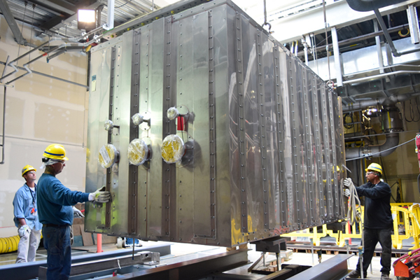 A section of the thermal catalytic oxidizer is lowered into the Low-Activity Waste Vitrification Facility.