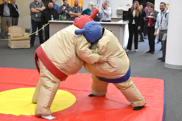 Vit Plant managers hold a sumo wrestling match during a fundraiser for cancer research.
