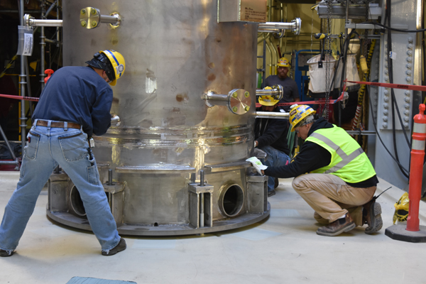 Vit Plant employees hand-maneuvered the caustic scrubber into position at the LAW Facility.