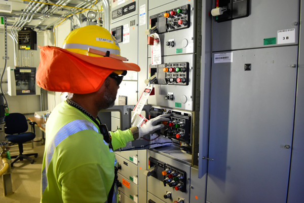A Startup electrician safely opens a utility systems control panel at Hanford's Waste Treatment and Immobilization Plant. Workers have transferred 70 percent of utility systems from the construction phase to the startup phase.