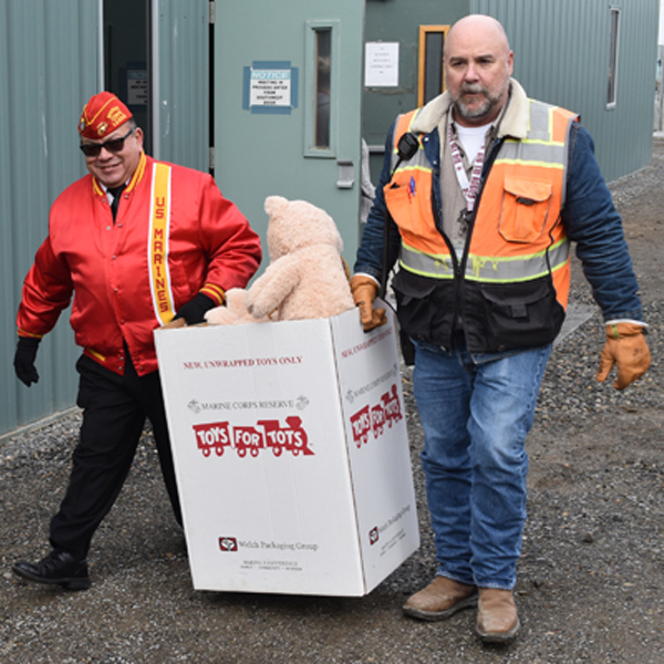 Andrew Lacey, a Vit Plant superintendent, and Michael Ridgel, local Toys for Tots coordinator, load toys into a truck for delivery at the Hanford Vit Plant jobsite.