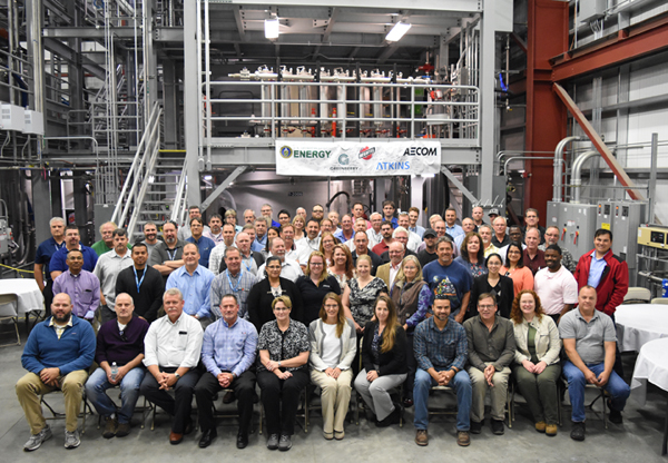 Employees from the Office of River Protection, Bechtel National, AECOM, and Atkins Engineering celebrate the completion test operations for the final phase of full-scale testing of pulse jet mixer vessels and control systems.