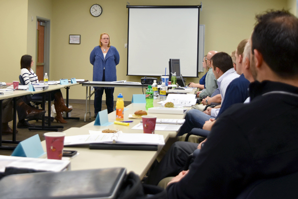 Project Director Peggy McCullough discusses commercial-grade dedication with suppliers at a recent workshop