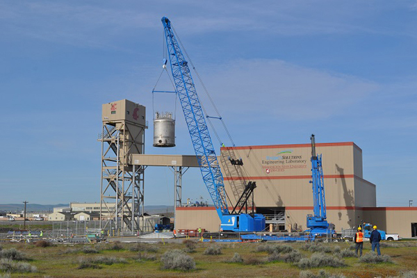 A 30-ton stainless steel vessel is lifted out of the Full-Scale Vessel Test Facility
