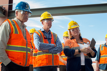 (From left) Secretary of Energy Rick Perry, Congressman Greg Walden, and Peggy McCullough, Bechtel's Project Director for the Hanford Vit Plant, listen to a presentation at the Pretreatment Facility.