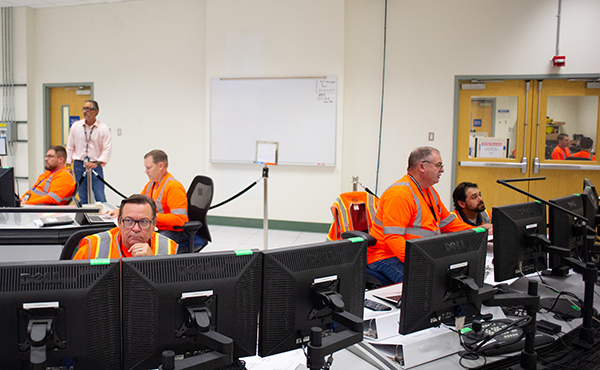Workers safely monitor systems from inside a computerized control room in the annex of the plant's Low-Activity Waste Facility.