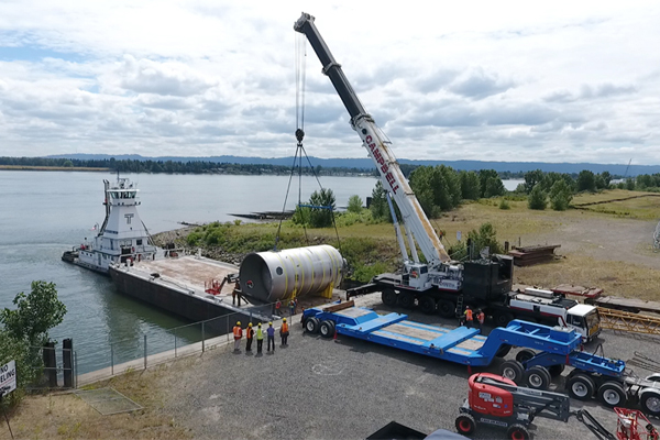 A 65-ton stainless steel test vessel is prepared to be barged up the Columbia River from Vancouver, Washington on Monday, July 11.