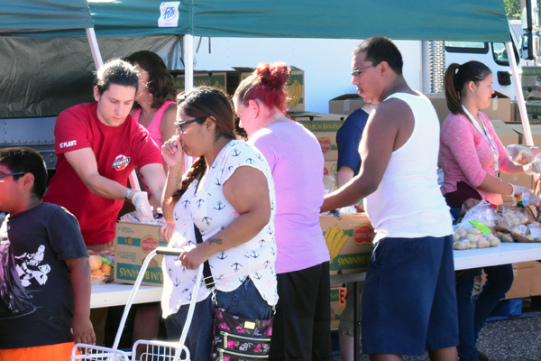 Vit Plant volunteers helped distribute food to needy families in the community at the Second Harvest Mobile Food Bank.