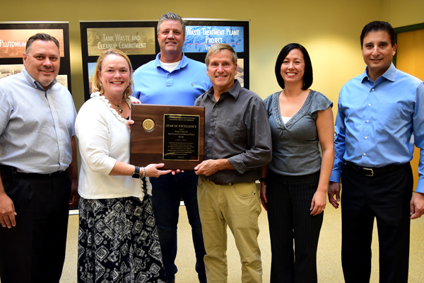 Vit Plant managers pose with the VPP Star of Excellence plaque and the DOE-VPP representative.